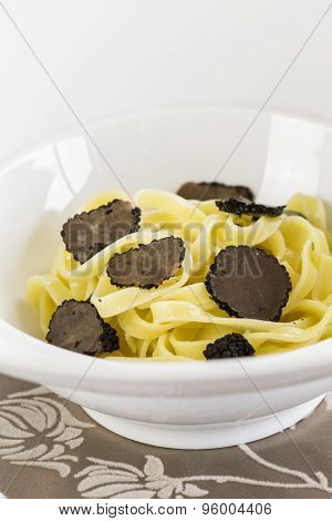 Serving Of Pasta With Black Perigord Truffles