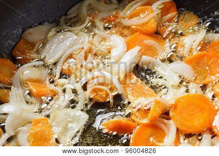 Onions And Carrots In The Pan.