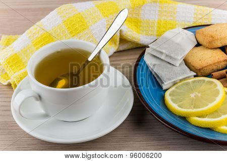 Hot Green Tea And Plate With Slices Of Lemon, Cinnamon