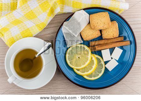 Cup Of Hot Tea, Sugar, Cinnamon Sticks, Slices Of Lemon