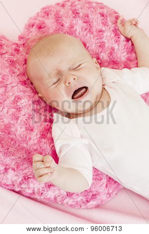 portrait of crying three months old baby girl