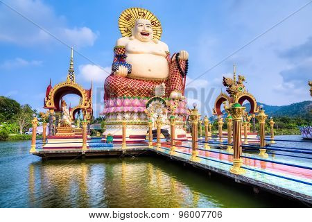 Smiling Buddha of wealth statue
