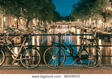 Night  illumination of Amsterdam canal and bridge