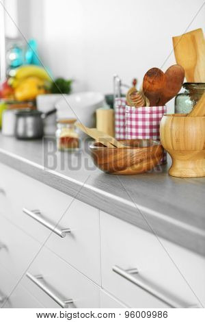 Composition with different utensils on wooden wooden table in kitchen
