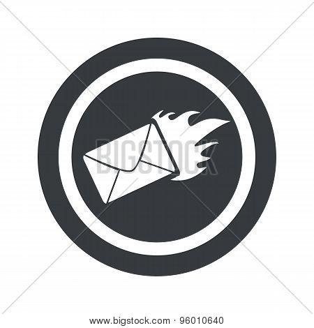 Round black burning letter sign