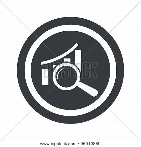 Round black graphic examination sign