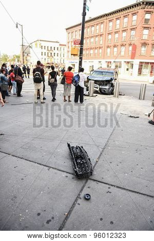 Grill of smashed SUV on sidewalk