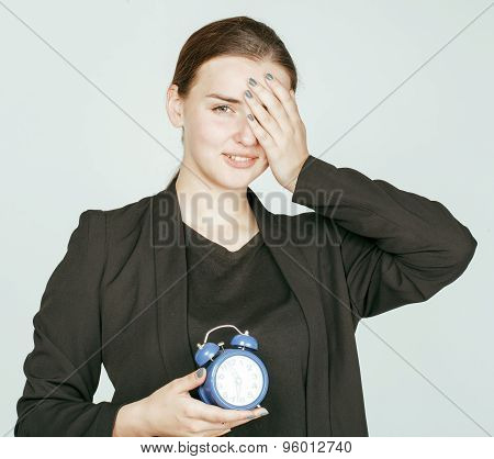 young beauty woman in business style costume waking up for work early morning