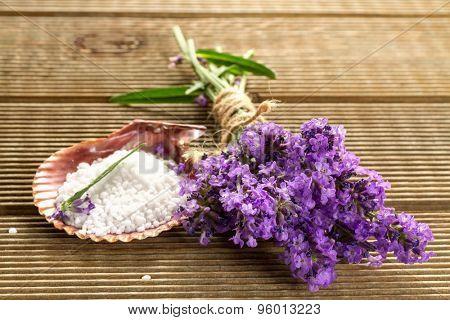 Lavender bundle and bath salt  on wooden background