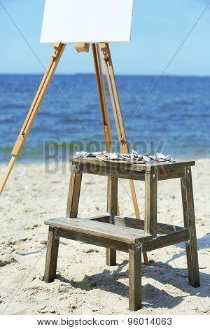 Easel with canvas on beach