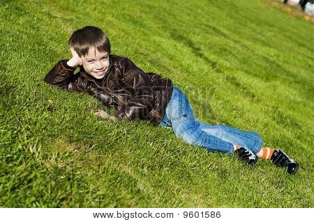 Little boy Lying Down on the grass