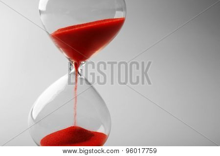 Hourglass on grey background
