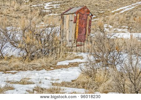 Rusty Outhouse