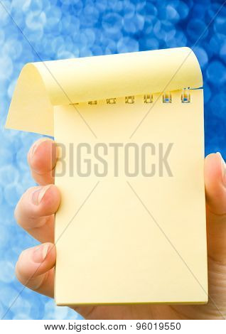Hand Holding Notepad