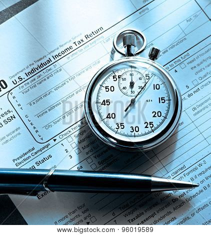 Tax Form, Pen And Stopwatch