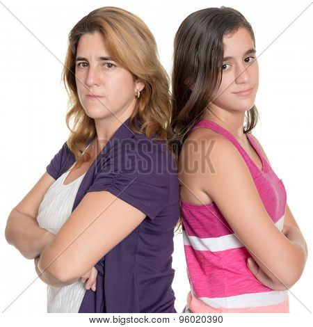 Teenage girl and her mother angry at each other standing back to back isolated on white