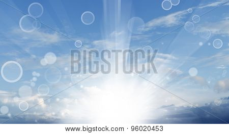 Bright rays of light in blue sky