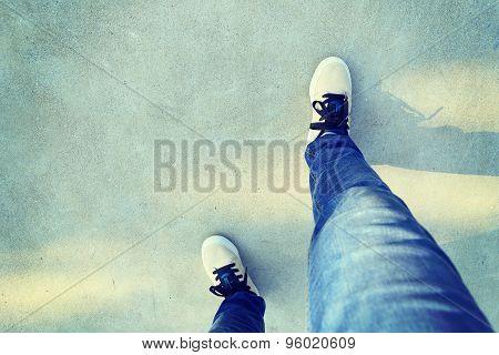 closeup of skateboarder relax legs on skatepark ramp