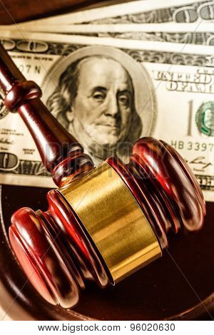 Wooden Gavel And Dollar Banknotes