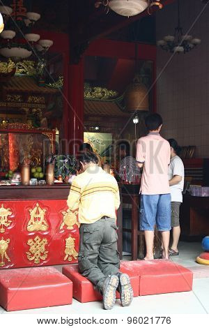 The believers pray at Muara Terbas Chinese temple, Kuching, Sarawak