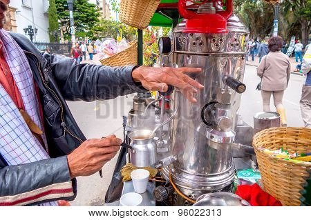 Unidentified street vendor selling fresh coffee at Candelaria neighborhood in Bogota Colombia