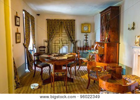 Living room at museum of Simon Bolivar residence in Bogota showing round coffee table with wooden ch