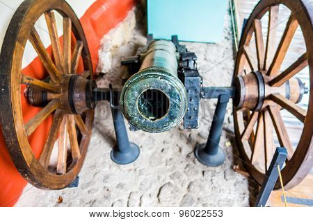 Frontal view of an old canon with wheels from Museum Quinta Simon Bolivar Bogota Colombia