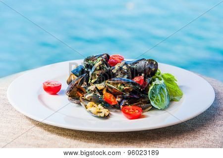 Mussels With Tomatoes On The Background Of The Sea