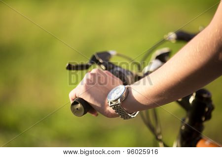 Young Woman Hand On Bike Handle