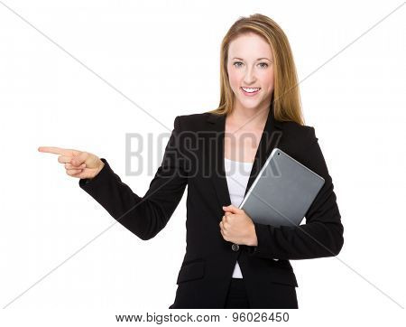 Businesswoman hold with tablet pc and finger point aside