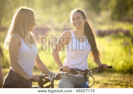Happy Teenage Bicyclists Girls