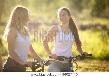 Happy Teenage Bicyclists Girls