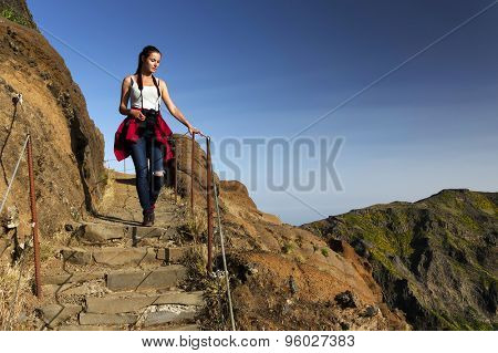 Young girl on the winding mountain trekking path at Pico do Areeiro, Madeira, Portugal