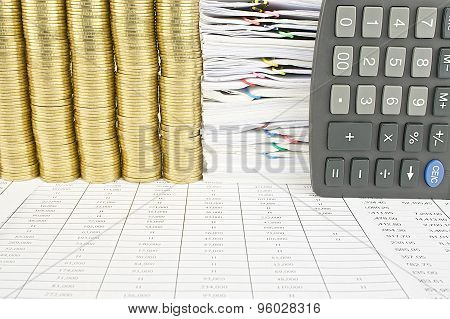 Pile Of Gold Coins And Calculator Place Vertical