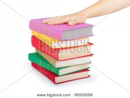 Hand On A Stack Of Books Isolated On White