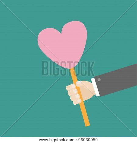 Businessman Hand Holding Paper Heart On The Stick Flat Design