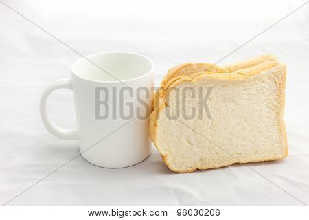 Empty Coffee Cup Or Coffee Mug And Sliced Bread Isolated On White Background