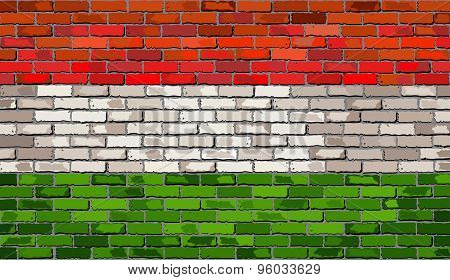 Grunge Flag Of Hungary On A Brick Wall