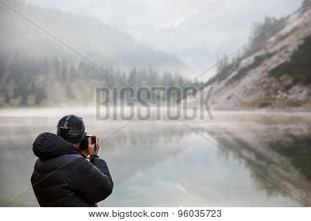Photographer Holding A Camera, Taking Photos