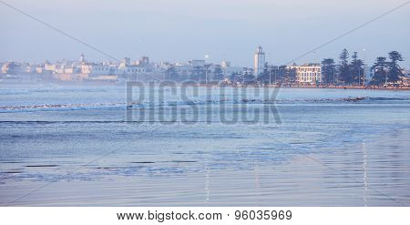 City and Wilaya  in  mist  at sunset., view from the beach.  Essaouira , Morocco.