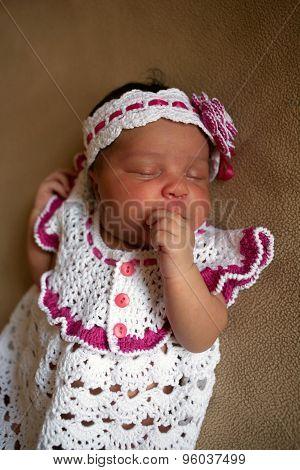 Newborn Black Baby Sucks His Thumb.