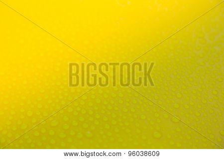 Drops of water on yellow floor
