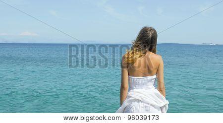 Young Woman Looking At The Horizon