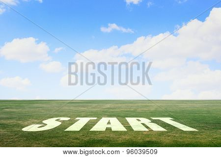 Start word as motivation writen on green grass
