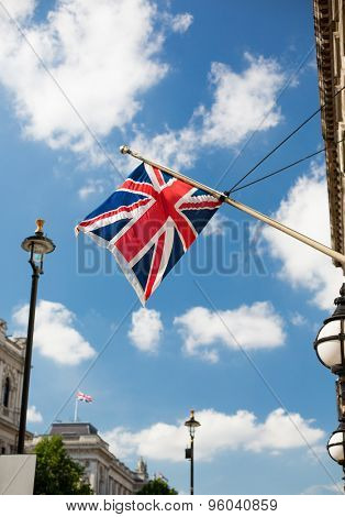 state sybols and national holidays concept - british nion jack flag waving on london city street