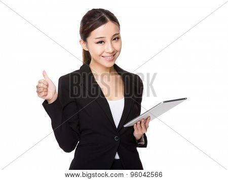 Young businesswoman hold with tablet and thumb up
