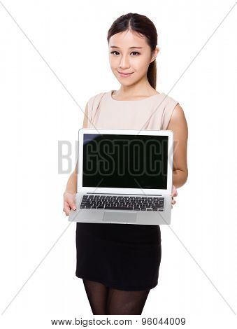 Asian Young woman show blank screen of laptop computer