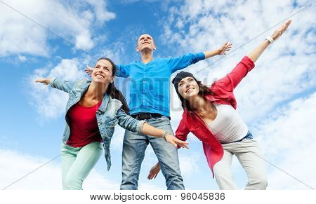 sport, dancing and urban culture concept - group of teenagers spreading hands