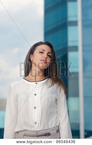 Business Woman Is On The City's Business District Smiling