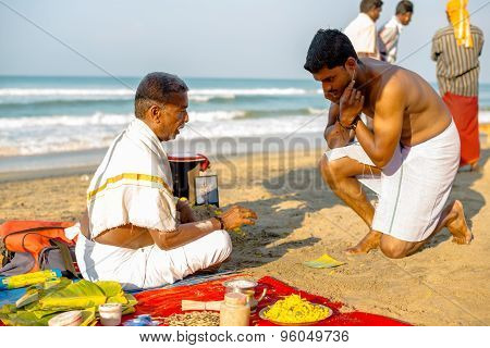 Varkala, India - February 22, 2013: Hindu Brahmin With Religious Attributes Providing Ceremony
